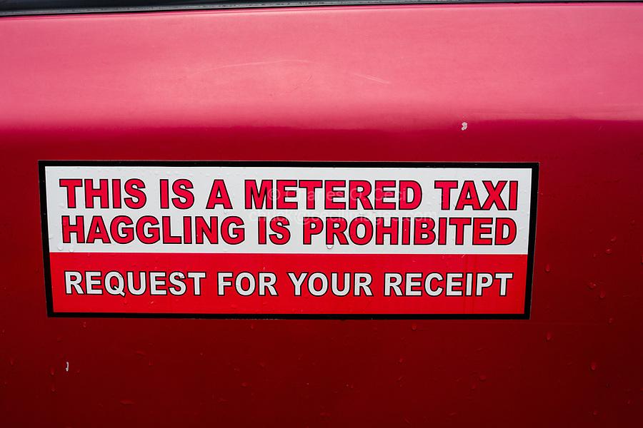 Taxi Sign, Haggling Prohibited. Jalan Petaling Street Market, Chinatown, Kuala Lumpur, Malaysia.