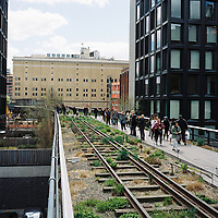 People walk the High Line in Manhattan, New York on Sunday, April 29, 2018. (Photo by James Brosher)