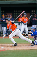 Daniel Pinero (22) of the Virginia Cavaliers follows through on his swing against the Seton Hall Pirates at The Ripken Experience on February 28, 2015 in Myrtle Beach, South Carolina.  The Cavaliers defeated the Pirates 4-1.  (Brian Westerholt/Four Seam Images)