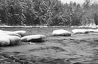 Large round pillows of snow cover rocks in the Menominee River. Piers Gorge, Norway, MI
