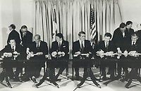 1985 FILE PHOTO - ARCHIVES -<br /> <br /> Signing session: Senior officials from Canada and the U.S. sign agreements, including pacts on trade, international security, North American air defence systems, law enforcement, acid rain and West coast salmon fishing yesterday, at the conclusion of the 24-hour Shamrock Summit in Quebec city.<br /> <br /> 1985<br /> <br /> PHOTO :  Erin Comb - Toronto Star Archives - AQP
