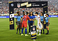 CHARLOTTE, NC - OCTOBER 03: Ali Krieger #11 of the United States and KIM Hyeri #20 of the Korea Republic exchange banners during a game between USA and Korea Republic at Bank of American Stadium, on October 03, 2019 in Charlotte, NC.