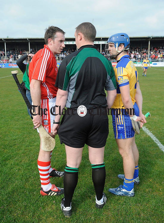 Captains John Gardiner and Gerry O Grady are spoken to by referee Alan Kelly before their NHL game at Cusack Park. Photograph by John Kelly..