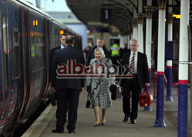 The Queen boards the train from platform one at Kings Lynn Railway station, Norfolk  at the end of her Christmas  holiday at Sandringham