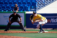 Michigan Wolverines first baseman Jesse Franklin (7) holds a runner on as umpire Mark Spicer looks on during a game against Army West Point on February 17, 2018 at Tradition Field in St. Lucie, Florida.  Army defeated Michigan 4-3.  (Mike Janes/Four Seam Images)