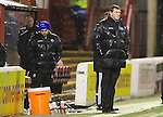 Motherwell v St Johnstone.....01.01.14   SPFL<br /> The expressions on the faces of Tommy Wright and Callum Davidson say it all<br /> Picture by Graeme Hart.<br /> Copyright Perthshire Picture Agency<br /> Tel: 01738 623350  Mobile: 07990 594431