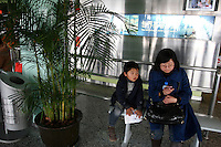 CHINA. Shanghai. A mother and child in the Oriental Pearl Tower. 2008.