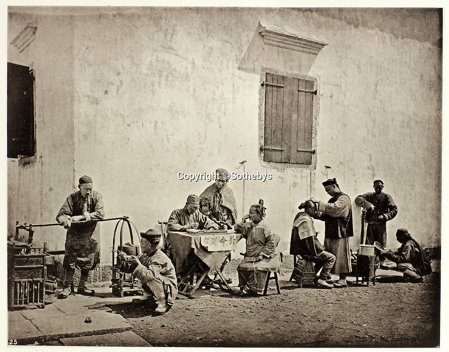 BNPS.co.uk (01202 558833)<br /> Pic: Sothebys/BNPS<br /> <br /> Street scene Kiu-Kiang - l-r food vendor, public scribe, barber and wood turner.<br /> <br /> Rare early photographs revealing what life in China looked like for the first time to the 19th century public have emerged 140 years after they were taken. <br /> <br /> The stunning collection - comprising 200 black and white photographs of Far East landscapes and wide-ranging personal portraits of everybody from rural peasants to senior government officials - was the first volume of photos from the region to ever be included in a travel book. <br /> <br /> Produced at a time when camera technology was still in its infancy, they were taken by celebrated Scottish photographer John Thomson between 1873 and 1874 during a 4,000-mile expedition across the country. <br /> <br /> And now one of the last remaining copies of the album still known to exist is set to go under the hammer at Sotheby's in London on November 7 with an estimate of £35,000.