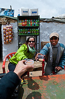 Toasting a cup of tea after mountain biking on the highest motorable road in the world,  Himalayan Mountains, Ladakh, India.
