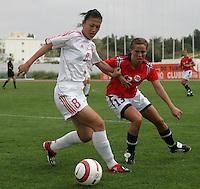 MAR 15, 2006: Albufeira, Portugal:  Ying Zhang, Camilla Huse