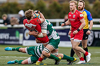 Leroy Van Dam of Jersey Reds is tackled during the Championship Cup QF match between Ealing Trailfinders and Jersey Reds at Castle Bar, West Ealing, England  on 22 February 2020. Photo by David Horn.
