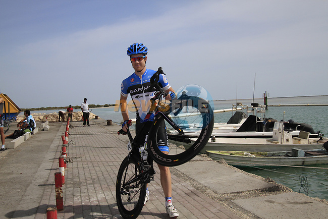 Garmin-Cervelo team sprinter Tyler Farrar (USA) with his bike before the start of Stage 4 of the 2012 Tour of Qatar from Al Thakhira to Madinat Al Shamal, Qatar. 8th February 2012.<br /> (Photo Eoin Clarke/Newsfile)