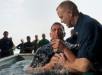 110508-N-DR144-024 ARABIAN SEA (May 8, 2011) Chaplain Lt. Gregory Hazlett baptizes Aviation Boatswain's Mate (Fuel) Jovan Michel on the fantail of Nimitz-class aircraft carrier USS Carl Vinson (CVN 70). Carl Vinson and Carrier Air Wing (CVW) 17 are underway in the U.S. 7th Fleet area of responsibility. (U.S. Navy photo by Mass Communication Specialist 2nd Class James R. Evans / Released)