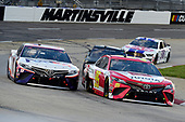 MARTINSVILLE, VIRGINIA - JUNE 10: Christopher Bell, driver of the #95 Toyota Toyota, and Denny Hamlin, driver of the #11 FedEx Freight Toyota, lead the field during the NASCAR Cup Series Blue-Emu Maximum Pain Relief 500 at Martinsville Speedway on June 10, 2020 in Martinsville, Virginia. (Photo by Jared C. Tilton/Getty Images)