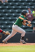 Luis Guillorme (13) of the Savannah Sand Gnats follows through on his swing against the Hickory Crawdads at L.P. Frans Stadium on June 14, 2015 in Hickory, North Carolina.  The Crawdads defeated the Sand Gnats 8-1.  (Brian Westerholt/Four Seam Images)