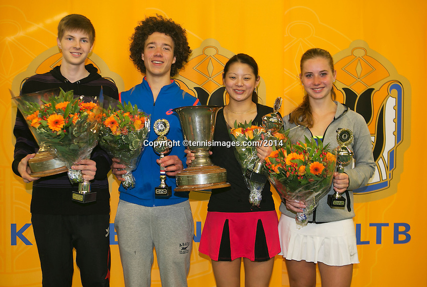 Rotterdam, The Netherlands, 15.03.2014. NOJK 14 and 18 years ,National Indoor Juniors Championships of 2014, Trophy giving on court, winner boys 18 years Gijs Brouwer(L) and runner up boys 18 years Casper Bonapart and winner  girls 18 years Arianne Hartono(L) and runner up Inger van Dijkman.<br /> Photo:Tennisimages/Henk Koster