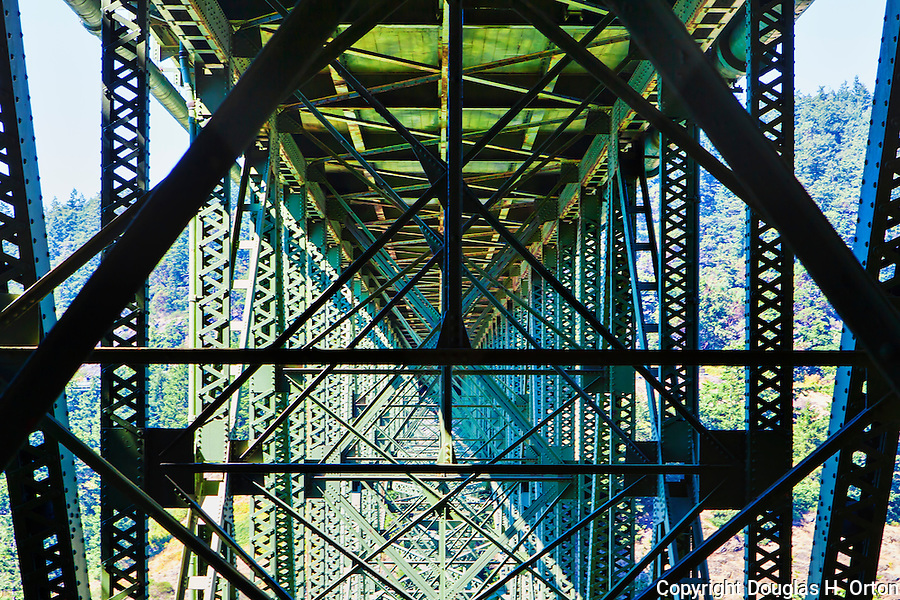 Under the World famous Deception Pass Bridge seen from North Beach in Deception Pass State Park, Washington, USA.  The bridge connects Fidalgo and Whidbey Islands in Puget Sound via Washington State Highway Route 20 near the towns of Anacortes and Oak Harbor.