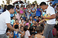 Philippines. Province Eastern Samar. Hernani. Barangay (neighbourhood) Batang. The Non-governmental organization (NGO) Terre des hommes (Tdh) distributes biscuits and candy bars to a group of children. 95 % of the town was destroyed by typhoon Haiyan's winds and storm surge. Typhoon Haiyan, known as Typhoon Yolanda in the Philippines, was an exceptionally powerful tropical cyclone that devastated the Philippines. Haiyan is also the strongest storm recorded at landfall in terms of wind speed. Typhoon Haiyan's casualties and destructions occured during a powerful storm surge, an offshore rise of water associated with a low pressure weather system. Storm surges are caused primarily by high winds pushing on the ocean's surface. The wind causes the water to pile up higher than the ordinary sea level. 24.11.13 © 2013 Didier Ruef