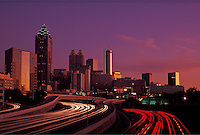 AJ4095, Atlanta, downtown skyline, Georgia, Skyline of downtown Atlanta and streaks of car lights on Downtown Connector Interstate I-85/I-75 from North Avenue at sunset in the state of Georgia.