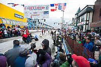 A dog team waits for the countdown to begin at the ceremonial start of the 43rd Iditarod dog sled race in downtown Anchorage. 79 mushers made their way 11 miles through the slushy streets of Anchorage in unseasonably warm weather and early rain. This year's official re-start will begin in Fairbanks because of poor trail conditions in Southcentral Alaska.