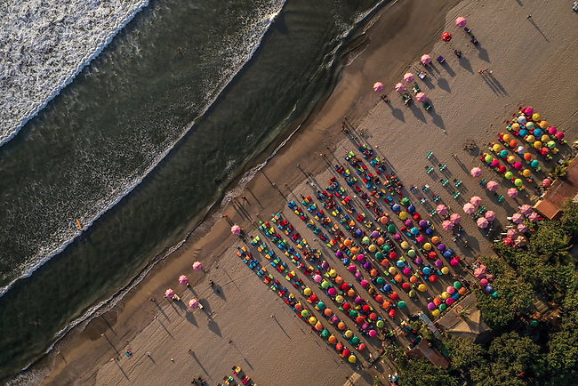 6 DECEMBER, 2019 BALI, INDONESIA: Crowd line the shore for sunset cocktails on Masari Beach, Seminyak in Bali. There has been a levelling out of Australian tourist numbers to Bali in recent times and tastes are changing regarding what people want from their holiday. Picture by Graham Crouch/The Australian