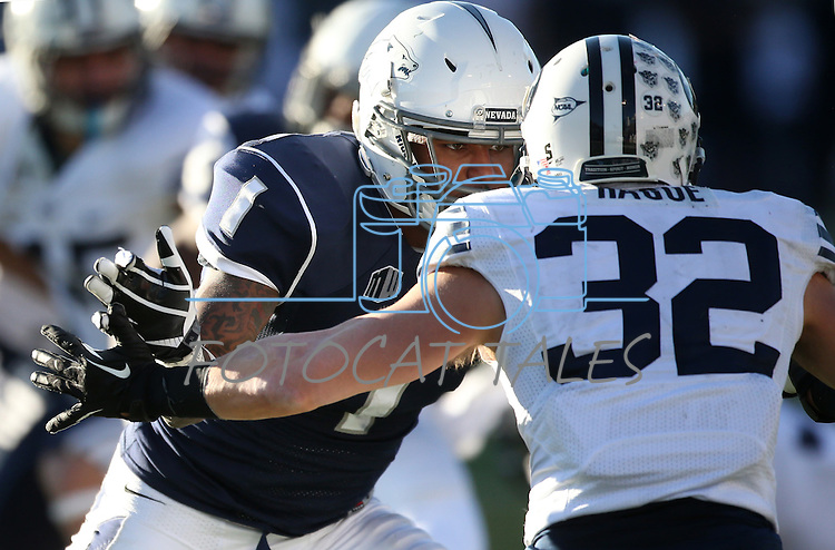 Nevada's Brandon Wimberly (1) and BYU's Mike Hague (32) compete in an NCAA college football game in Reno, Nev., on Saturday, Nov. 30, 2013. (AP Photo/Cathleen Allison)