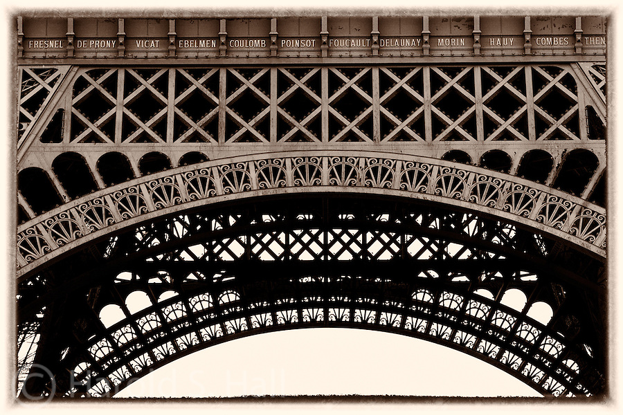 Seventy-two names appear on the Eiffel tower.  These are names of French scientists, physicists, chemists and mathematicians. There would be no noticeable difference between this photo and the way this section of the tower appeared when erected in 1889 as the entrance arch to that years World's Fair