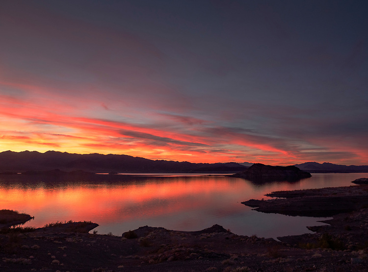Sunset over the River Mountains and Boulder Basin on Lake Mead as viewed from Painters Cove in the Lake Mead National Recreation Area (Photo from Arizona looking into Nevada)