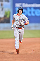 Lakewood BlueClaws designated hitter Henri Lartigue (11) rounds the bases during a game against the Beer City Tourists at McCormick Field on June 1, 2017 in Asheville, North Carolina. The Tourists defeated the BlueClaws 8-5. (Tony Farlow/Four Seam Images)