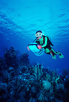 Scuba diver with underwater scooter, Turks and Caicos