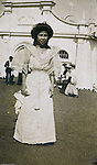 St Louis MO:  View of a Philippine woman greeting visitors at Philippine Village during the Louisiana Purchase Exposition.