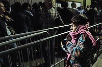 - immigrates in queue at the police headquarters of Cagni street (north periphery of Milan) for renew of the stay permission....- immigrati in coda alla questura di via Cagni (periferia nord di Milano) per il rinnovo del permesso di soggiorno