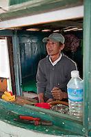Myanmar, Burma.  Boat Pilot in his Cabin, on the Ayeyarwady River  near Mandalay.