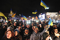 """The evening before summit in Vilnus. Crowd is cheering """"Sign, sign!"""" Thousands of people are continuing to express their support to european integration and protesting against decision of Ukrainian government to refuse signing of association with EU in Vilnius."""
