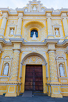 Antigua, Guatemala.  Entrance to La Merced Church, completed 1767.  Ataurrique Decorative Style.  San Pedro Nolasco, founder of the Mercedary Order, at the top of the facade.