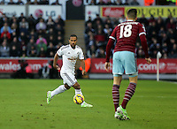 Pictured L-R: Wayne Routledge of Swansea against Carl Jenkinson of West Ham. Saturday 10 January 2015<br /> Re: Barclays Premier League, Swansea City FC v West Ham United at the Liberty Stadium, south Wales, UK