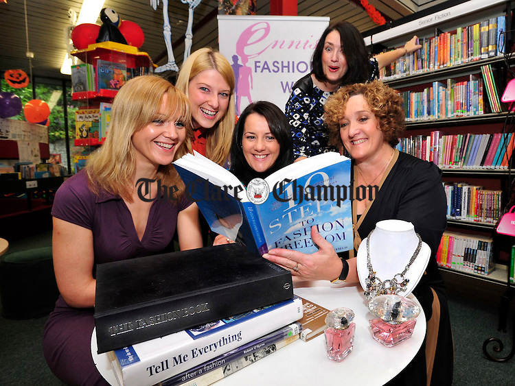 Ennis Fashion Week Committee members Rita Mc Inerney, Audrey Kinahan, Martina D'Auria, Maeve Culligan and Gwen Culligan doing their homework at Ennis Library for this year's Fashion Week . Photograph by Declan Monaghan