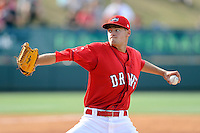 Starting pitcher Trey Ball (32) of the Greenville Drive delivers a pitch in his first Class A appearance against the Lexington Legends on Sunday, April 27, 2014, at Fluor Field at the West End in Greenville, South Carolina. Ball was the No. 1 pick of the Boston Red Sox in the 2013 First-Year Player Draft. He is the No. 10 Red Sox prospect, according to Baseball America. Greenville won, 21-6, and Ball got the win. (Tom Priddy/Four Seam Images)