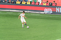 FOXBOROUGH, MA - MAY 22: Sean Nealis #15 of New York Red Bulls passes the ball during a game between New York Red Bulls and New England Revolution at Gillette Stadium on May 22, 2021 in Foxborough, Massachusetts.