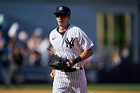 New York Yankees Ben Ruta (97) jogs to the dugout during a Spring Training game against the Toronto Blue Jays on February 22, 2020 at the George M. Steinbrenner Field in Tampa, Florida.  (Mike Janes/Four Seam Images)