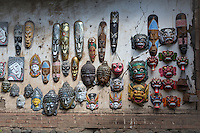 Bali, Indonesia.   Decorative Souvenir masks on Display for Sale to Tourists.  Tenganan Village.