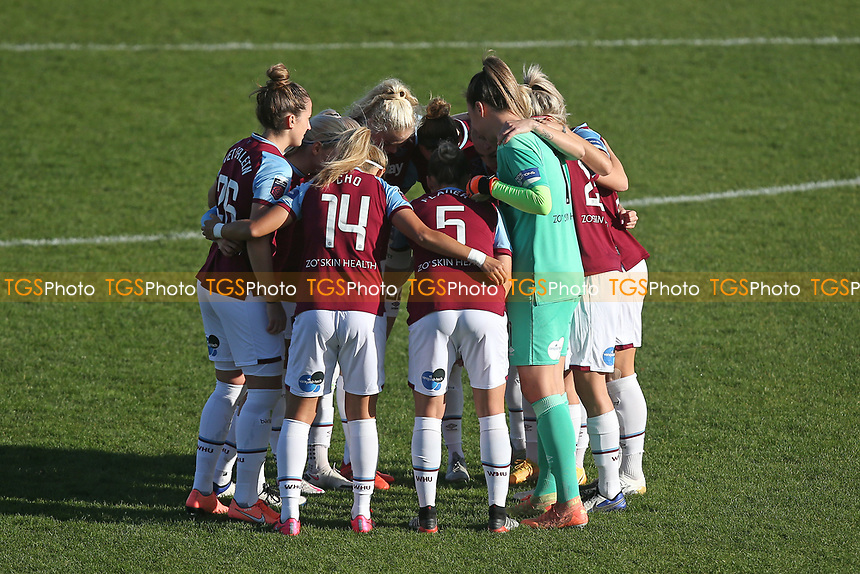 West Ham players huddle during West Ham United Women vs Brighton & Hove Albion Women, Barclays FA Women's Super League Football at the Chigwell Construction Stadium on 15th November 2020