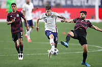 6th June 2021. Denver, Colorado, USA;  United States forward Christian Pulisic breaks past Mexico defender Nestor Araujo during the CONCACAF Nations League finals between Mexico and the United States  at Empower Field at Mile High in Denver, CO.