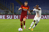 Roma s Edin Dzeko, right, is challenged by Benevento s Bryan Dabo during the Serie A soccer match between Roma and Benevento at Rome's Olympic Stadium, October 18, 2020.<br /> UPDATE IMAGES PRESS/Riccardo De Luca