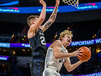 WASHINGTON, DC - JANUARY 28: Sean McDermott #22 of Butler clashes with Mac McClung #2 of Georgetown during a game between Butler and Georgetown at Capital One Arena on January 28, 2020 in Washington, DC.