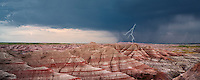 Panoramic view of colorfull rock formations with thunderstorm and lightning.. Badlands National Park, South Dakota.