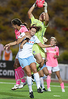 Jillian Loyden (right) grabs the ball over Whitney Engen (center) and Shannon Boxx (left). FC Gold Pride tied the Chicago Red Stars 0-0 in PUMA's Project Pink, Think Pink, Breast Cancer Awareness game at Pioneer Stadium in Hayward, California on August 7th, 2010.