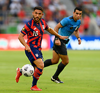 AUSTIN, TX - JULY 29: Cristian Roldan #10 of the United States passes the ball to a teammate during a game between Qatar and USMNT at Q2 Stadium on July 29, 2021 in Austin, Texas.