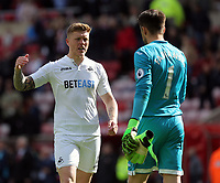 SUNDERLAND, ENGLAND - MAY 13: (L-R) Alfie Mawson of Swansea City with team mate Lukasz Fabianksi celebrate their team's win during the Premier League match between Sunderland and Swansea City at the Stadium of Light, Sunderland, England, UK. Saturday 13 May 2017