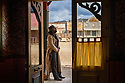 Spain - Andalusia - Diego García Junior, a 38-year-old stuntman who has been featured in several movies and music videos stands in the door frame of a store in Oasys Mini Hollywood.